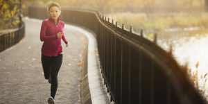 Woman running on waterfront path